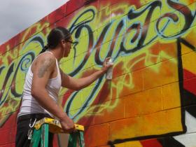 "Graffiti artist Focus working on the Pine Ridge Reservation's ""Hope"" mural"
