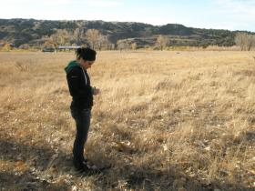 Maria Squillace an SDSM&T grad student at a soil sampling site near the Cheyenne River. Photo thanks to Dr. Jim Stone, SDSM&T.