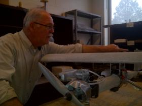 Dr. M.R. Hansen shows off the School of Mines concrete airplane.