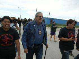 Tribal President Brian Brewer walking into Whiteclay.
