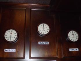 Clocks at The Wobbly Bobby show Rapid City time, London time and time for an ale.