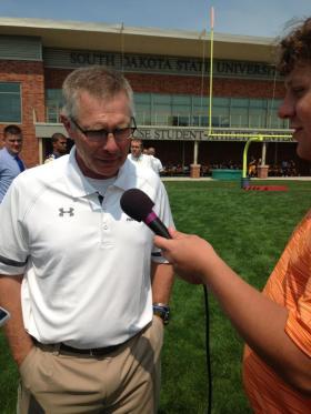 Coach John Stiegelmeier Talking with News Organizations During SDSU Media Day.