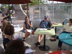 SDSU Associate Professor Christine Stewart (center) discusses ekphrasis with Rapid City community poets.