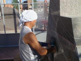Yuki Nagase uses diamond wheel to cut a deep groove in granite stone