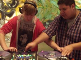 Jace Marchiando spins tunes with help from DJ MIcah