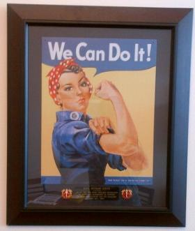 """A copy of classic World War Two """"Rosie The Riveter"""" poster hangs on State Command Sergeant Major Susan Shoe's office wall. It was presented to CSM Shoe by the 109th Regional Support Group,"""