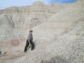 Ranger Julie Johndreau hiking Badlands National Park's Saddle Pass trail.