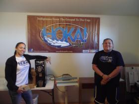 Sharice Davids and Hoka! Coffee business administrator Elaine Yellow Horse beside the company's banner.