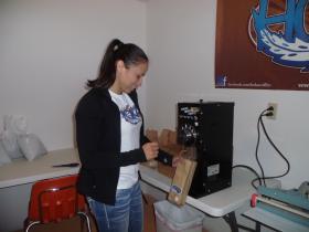 Sharice Davids brews some Hoka! Coffee at the company's office.