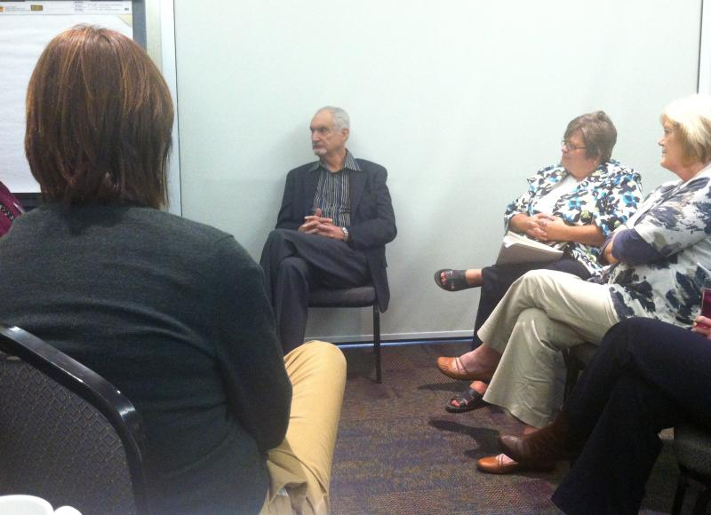 Dr. Carl Hammerschlag hosts an informal discussion following his speech to more than 700 health care professionals.