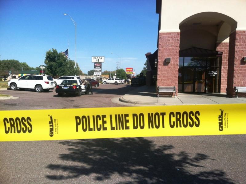 Police SWAT teams surround an armed suspect inside a Sioux Falls strip mall.