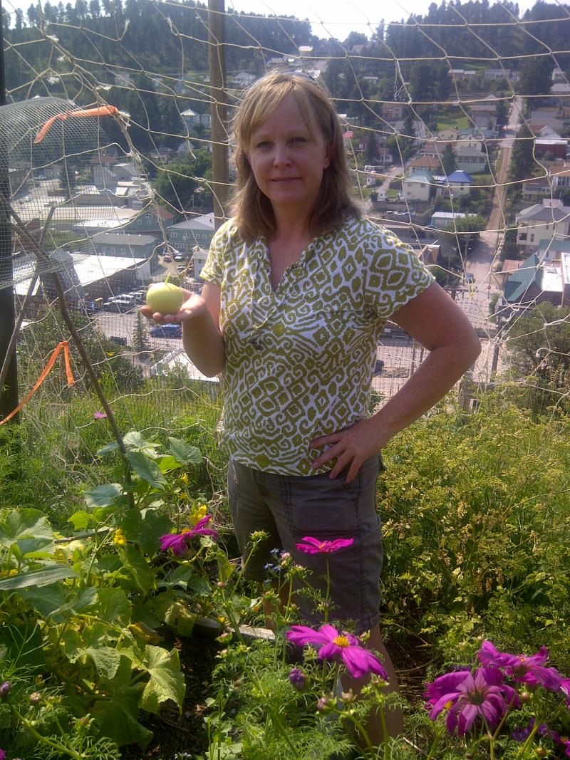 Darla Boehm-Auld holding a lemon cucumber at Lead's Mile High Community Garden