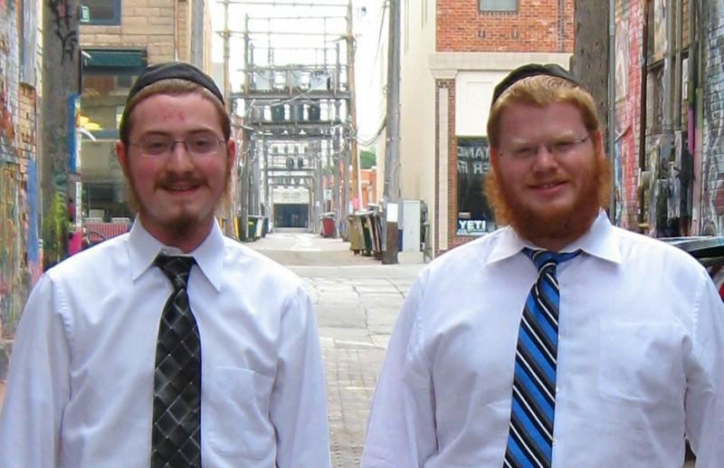 Yosef Sharfstein, left, and Shmuel Lefkowitz, the Roving Rabbis, visit Art Alley in Rapid City.