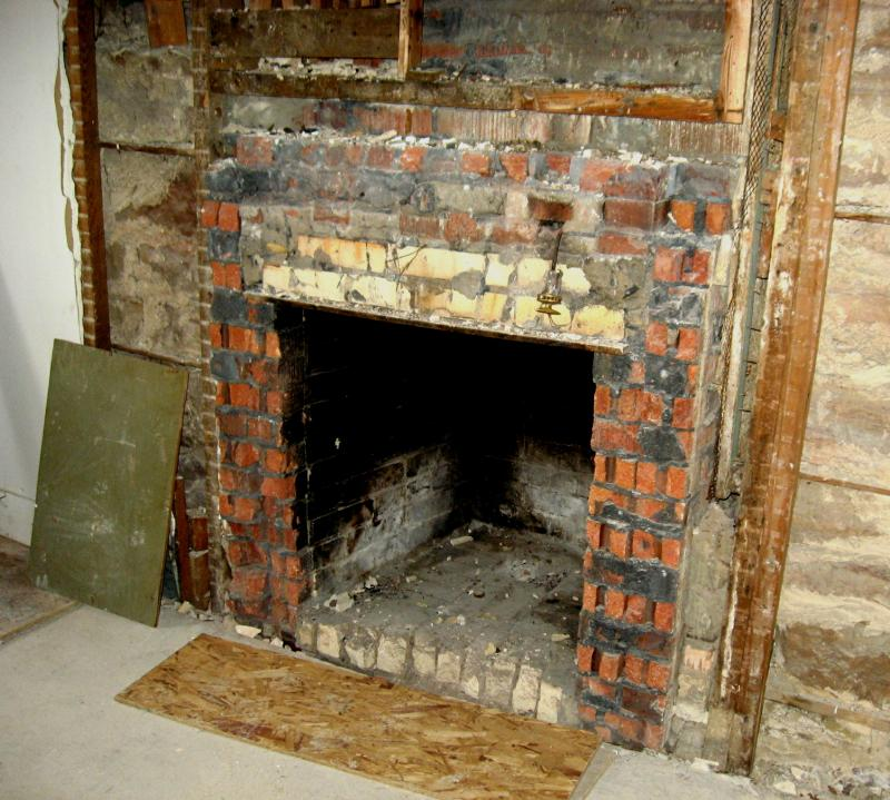 This fireplace was built in the opening where a window once was. The original fireplace was located across the room.