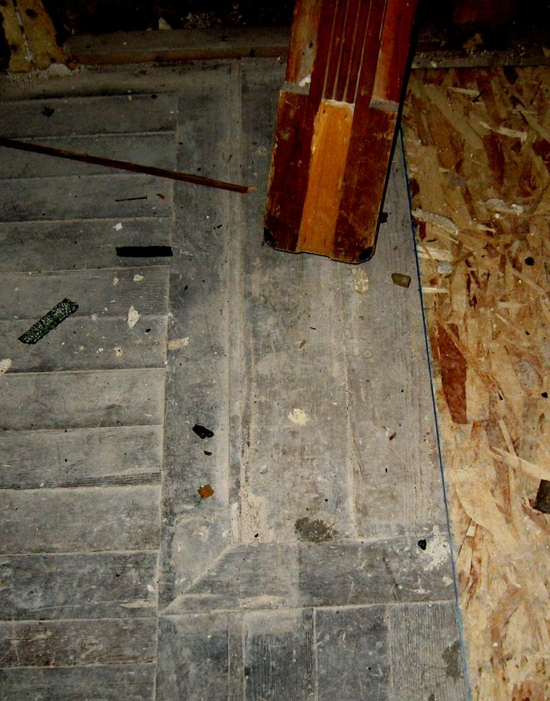 These lines on the floor show where the staircase once jutted away from the wall. It is now flush against the wall.