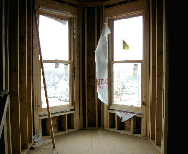 These new windows are installed in the reconstructed second story.