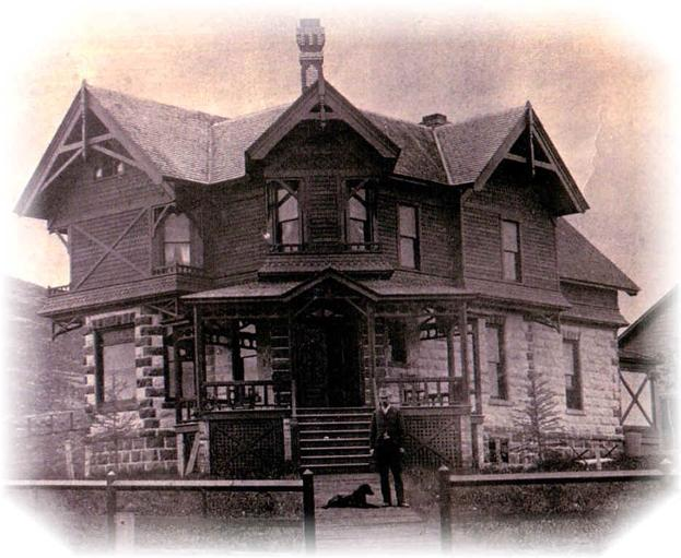The McGillycuddy House as built in 1887 by Valentine McGillycuddy, seen standing in front of the house with his dog.