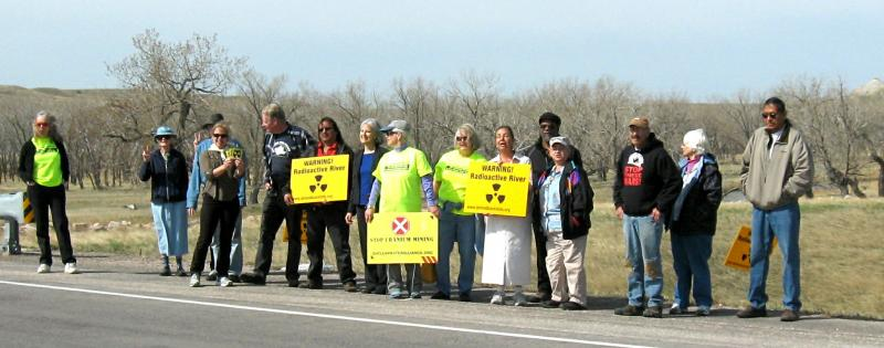 These activists stand on the Cheyenne River bridge to catch the attention of drivers.