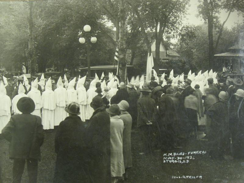 A photo of a KKK funeral at Sturgis is part of Charles Rambow's collection of memorabilia.