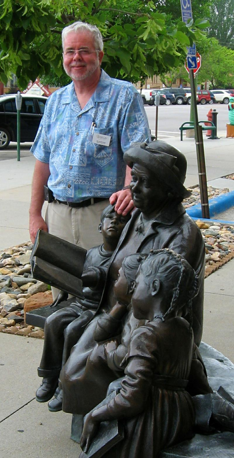 Jim McShane stands beside a sculpture outside the Rapid City Public Library.