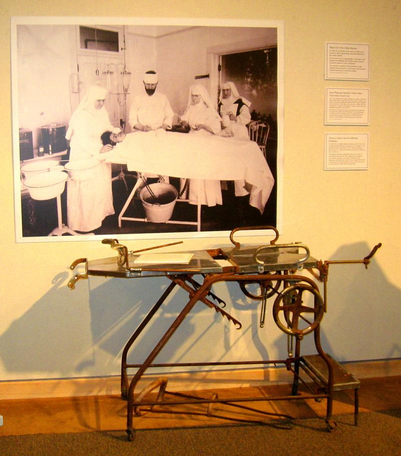 The surgical table is the one depicted in the photograph above it.