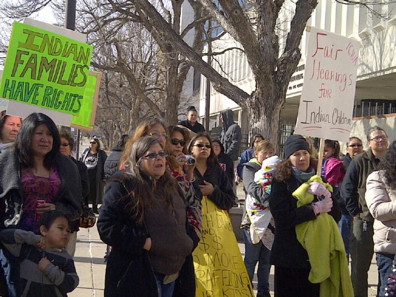 Demonstrators gather at the Federal Courthouse in Rapid City on March 21, 2013, to support the filing of the lawsuit.
