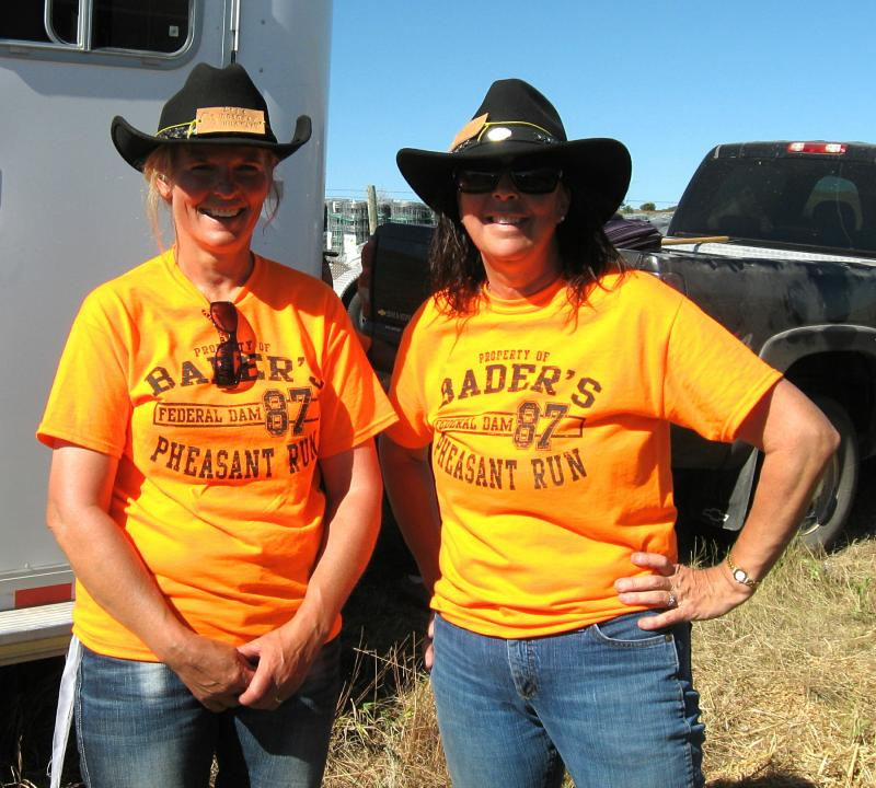 Deb Huoteri and Dee Ayers relax after riding in the roundup. Both women traveled from Minnesota to ride with the bison.