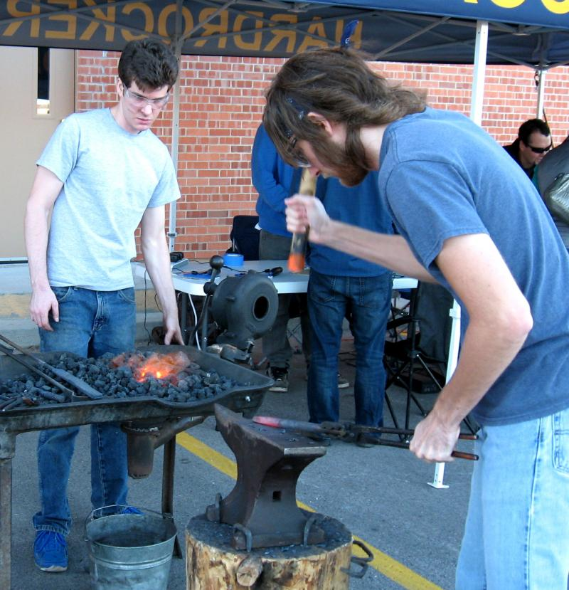 Michael Willman, left, and Ian Markon practice the ancient craft of blacksmithing.