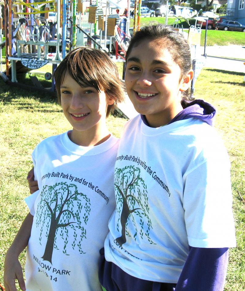 Kyla Hudelson, left, and Aaliyah Arguello volunteer time to create a playground at Willow Park.