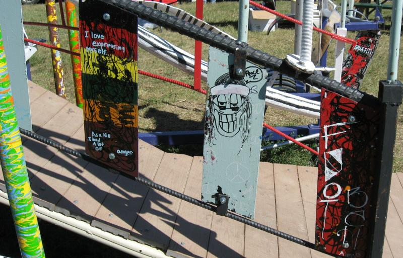 "Children's artwork is featured on the ""Will Be"" sculpture. Kids also painted the bars (see left)."
