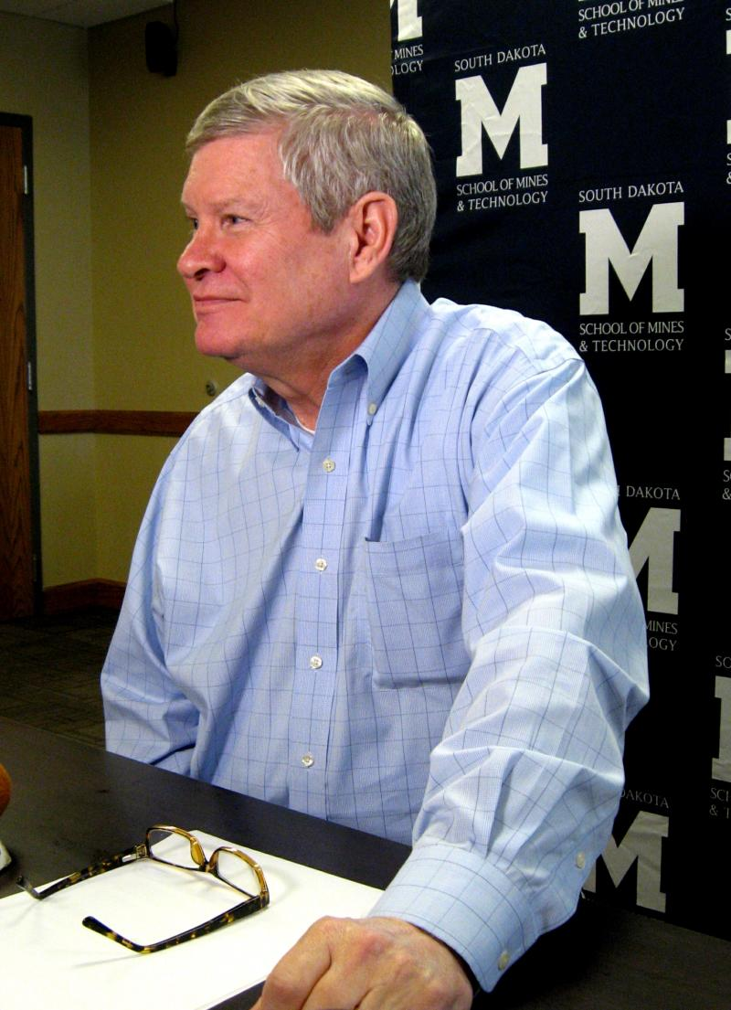 Senator Tim Johnson talks with journalists at the School of Mines Surbeck Center on Sunday afternoon..