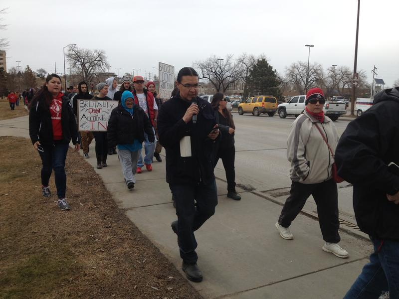 Chase Iron Eyes speaks to the crowd during the rally.