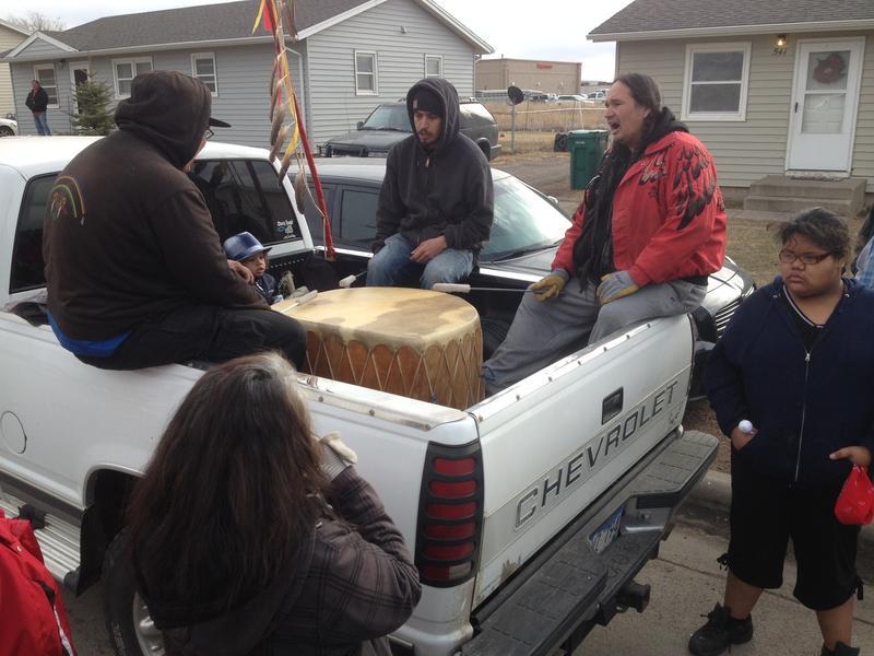 Lakota singers at a vigil folloing the police shooting on Saturday.