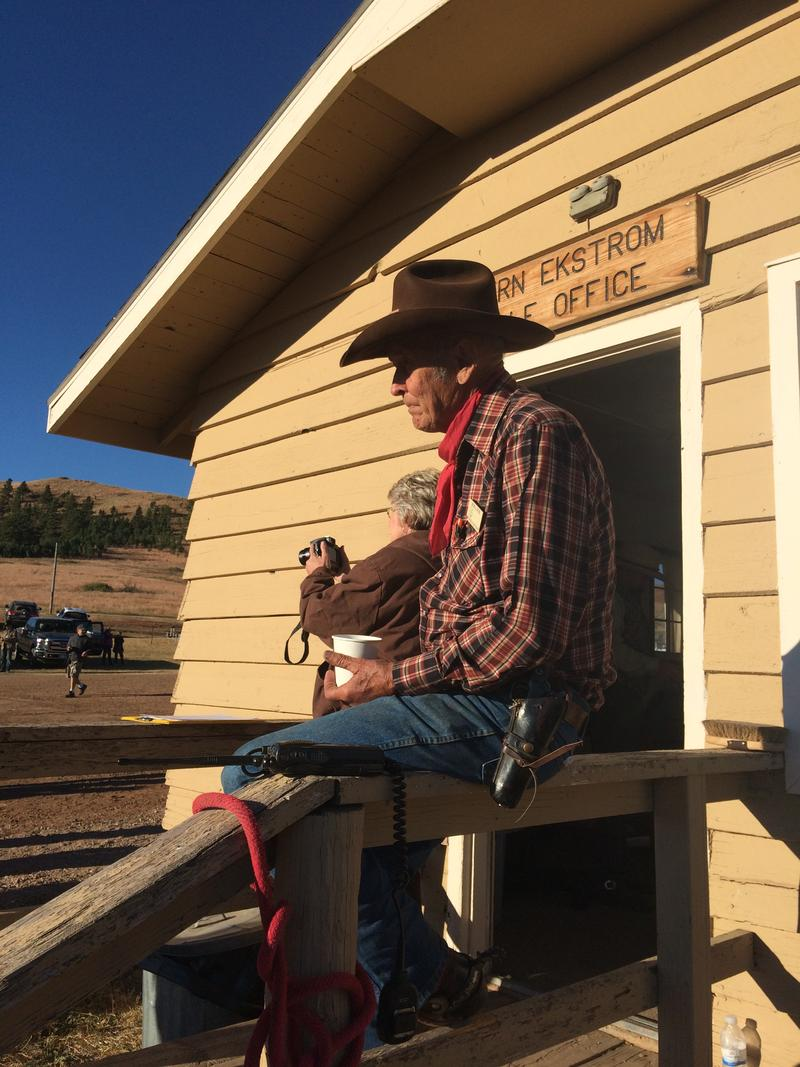 80 Year Old Bob Lantis drinks coffee while waiting for the wrangler briefing before the 2015 Custer State Park Buffalo Round Up.  Lants is one of a few lead riders who carries a pistol during the event.