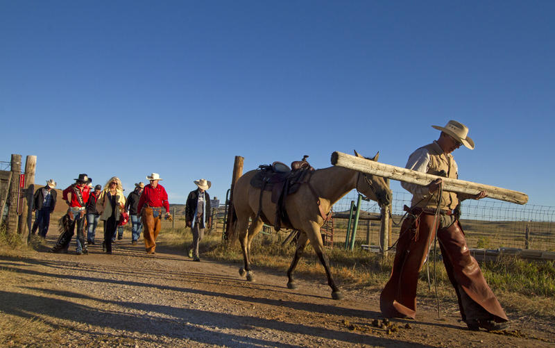 A crowd leaves their trailers and heads to the wrangler briefing before the Buffalo Roundup on Friday morning.