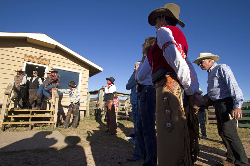 People gather for the Wrangler Meeting before the Buffalo Roundup on Friday morning.