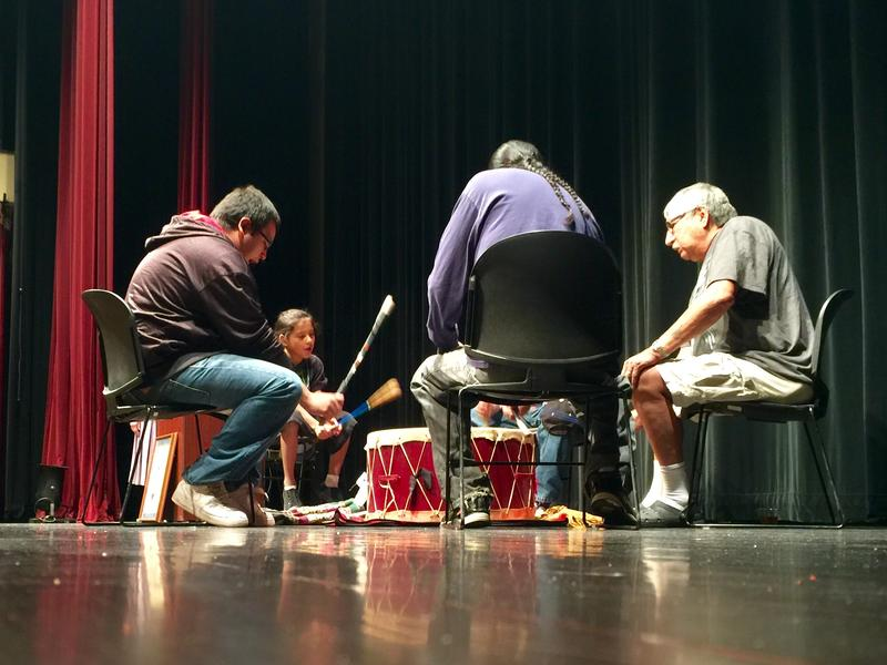 Dr. George Eagleman, two sons, and one grandson comprise the Eagle Spirit Drum Group. They opened a discussion about Native American Day.