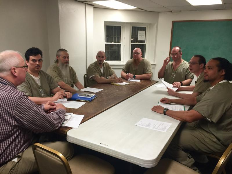 Pastor Bob Chell sits with St. Dysmas church council members. The inmate leaders include Christopher, T.J., Travis, Josh, Dave, Justin, and Donnie.