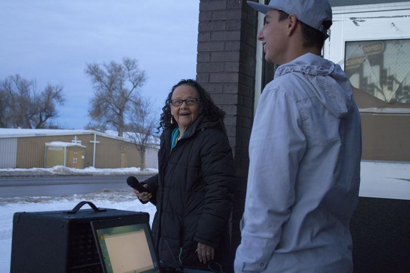 Tiny Decory and Brian Sherman prepare the sound system for the first parade of lights on Pine Ridge.