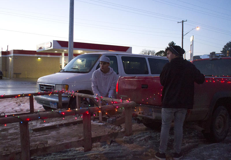 Members of the Bear Program prepare their vehicle for the parade of lights in Pine Ridge.