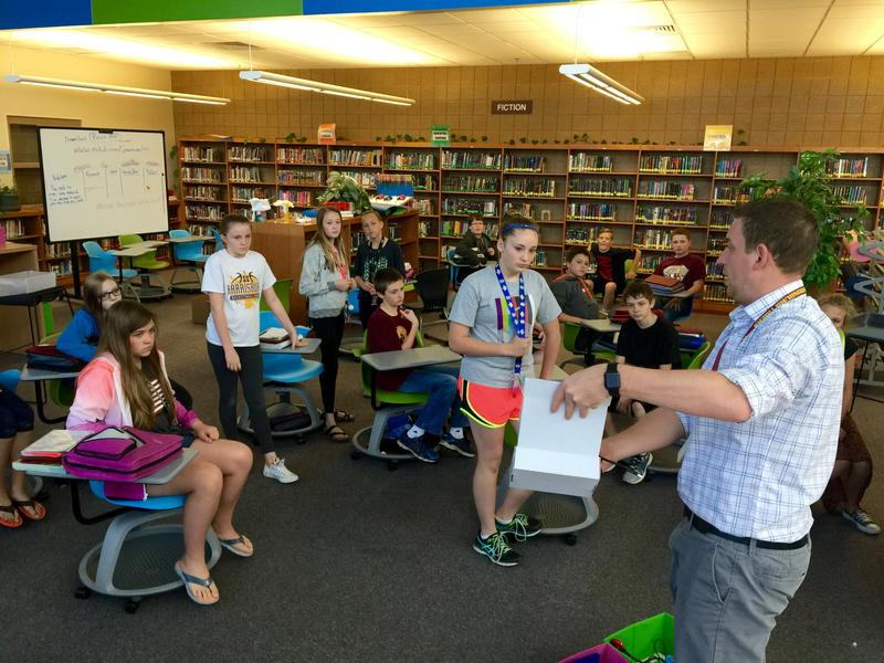 Technology Integrationist Travis Lape gives students quick direction while packing up the makerspace in Harrisburg.