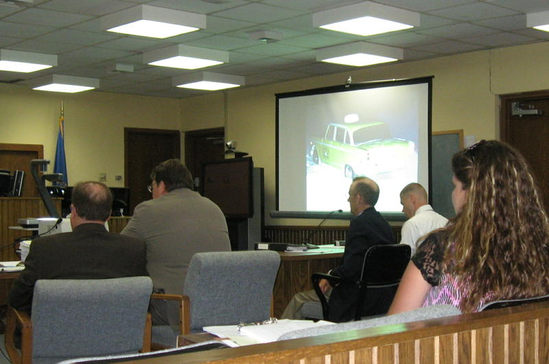 Inside the Stanley County courtroom, a photo of Mike Hare's cab is projected. Seated at tables are, from left, Assistant Attorney General Bob Mayer, Stanley County State's Attorney Tom Maher, Jensen's attorney Jeff Larson, and Jensen.