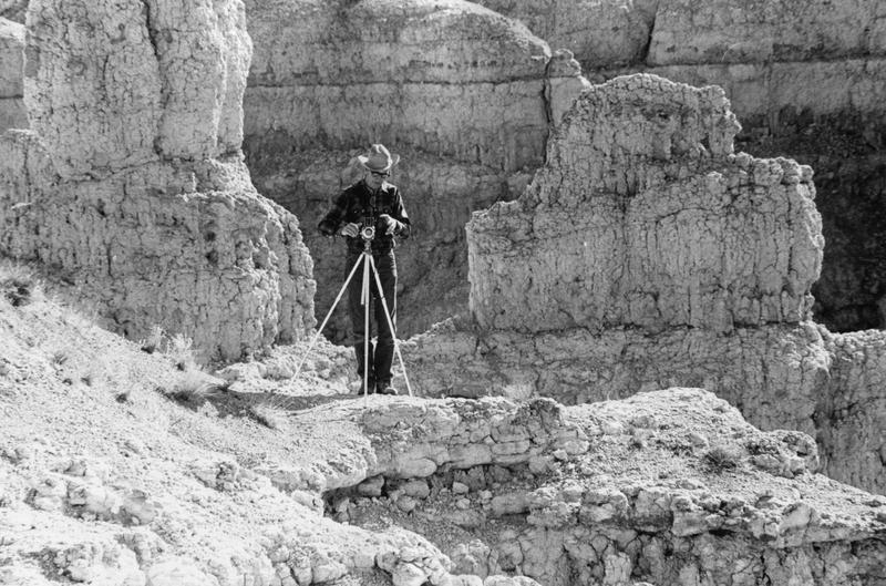 Earl Brockelsby taking a photograph in the Badlands