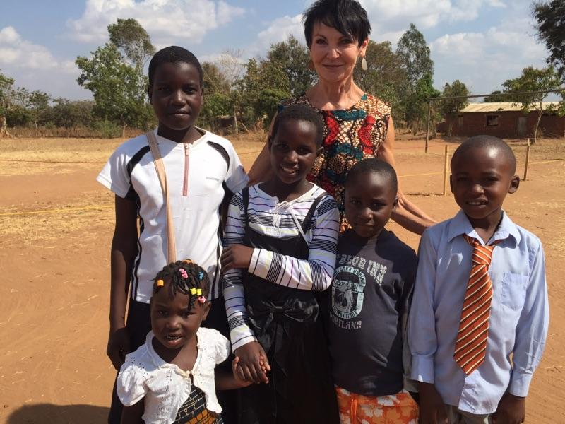 SD Education Secretary Melody Schopp with school children in Malawi