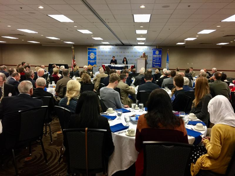 SD State Rep. Paula Hawks (D) and Congresswoman Krist Noem (R) prepare for a debate with moderator Jack Marsh. The Sioux Falls Downtown Rotary Club hosted the forum. / October 10, 2016