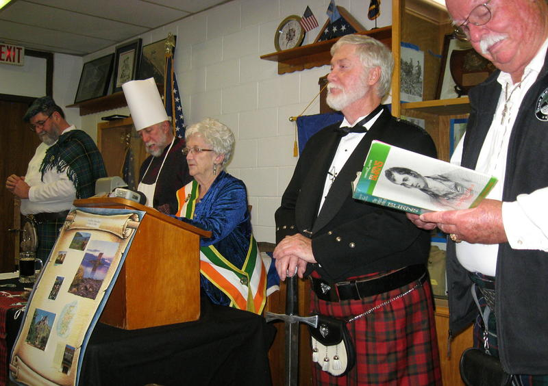 Participants in the ceremony of the haggis are, from left, Bill Knight, Mickey Hartnett, Brigid Flatley, Michael Nau, and Ron Hunter.