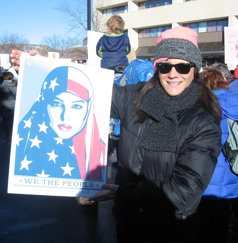 Kathy Keffeler holds one of three posters created by Shepard Fairey for the Women's March on Washington.
