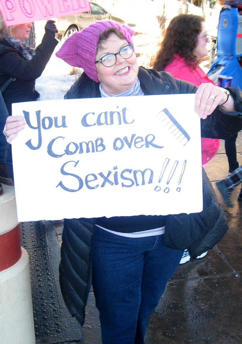 Pat Lien Francis takes a comedic approach with her sign, but her offense at the sexist rhetoric in this election is serious.