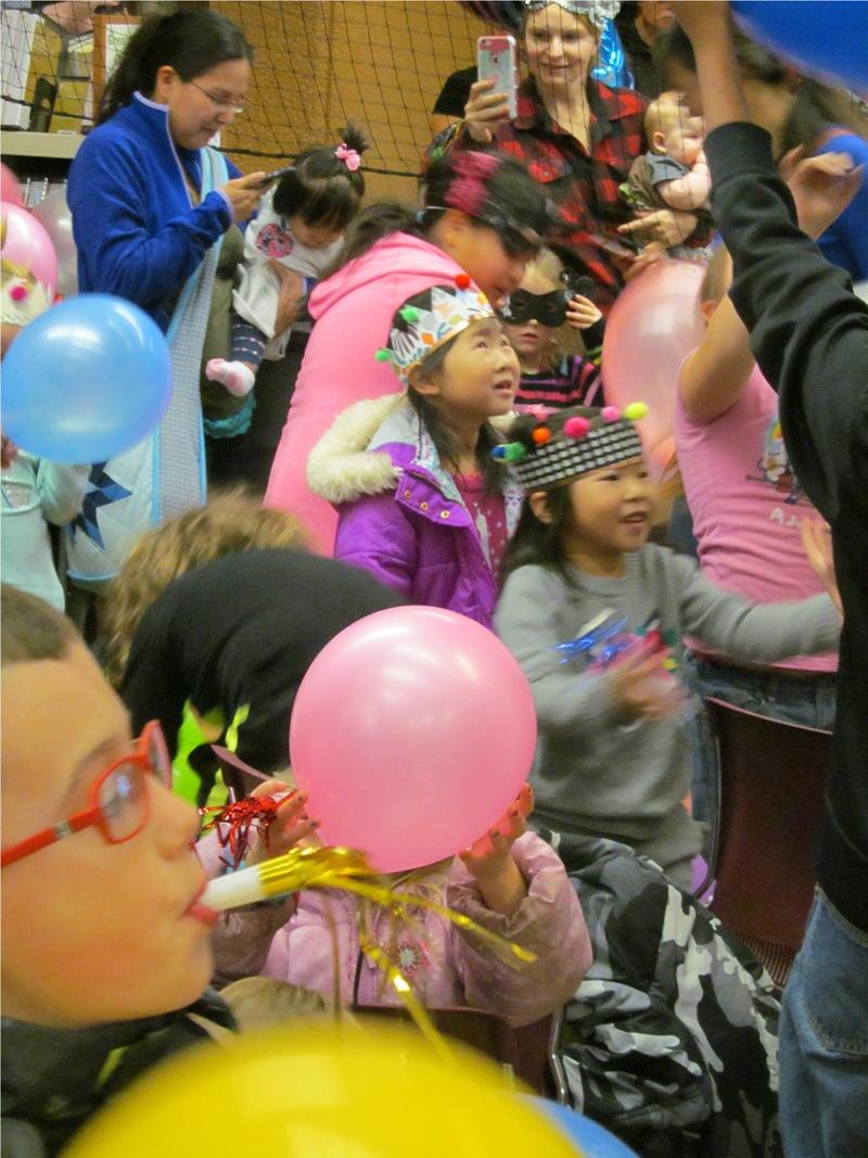 Children watch the balloons drop.
