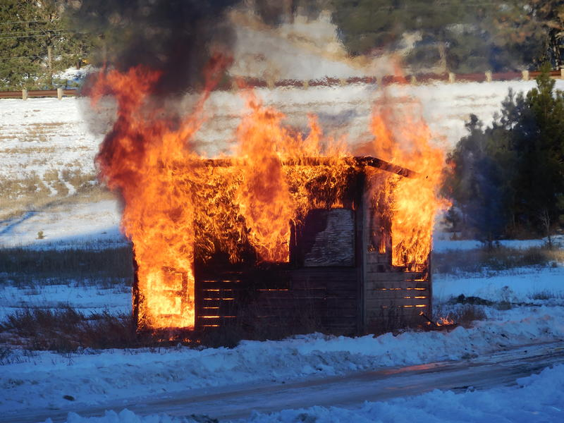 A nearby wooden structure was easily set ablaze.